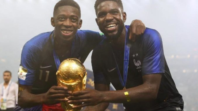 Ousmane-Dembele-and-Umtiti-of-France-with-World-Cup-trophy